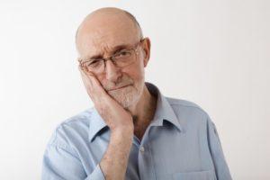 man experiencing dental implant failure in Sachse