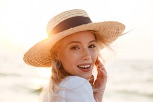 Woman at beach after seeing cosmetic dentist in Sachse